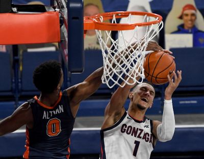Gonzaga's Jalen Suggs, who scored 18 points, draws a foul on Pepperdine's Sedrick Altman during the first half of the Bulldogs' 95-70 home win on Jan. 14.  (By Colin Mulvany / The Spokesman-Review)