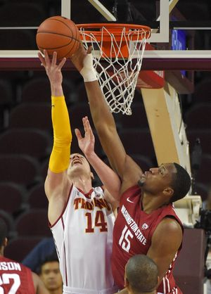 WSU's Junior Longrus blocks shot by Strahinja Gavrilovic. (Associated Press)