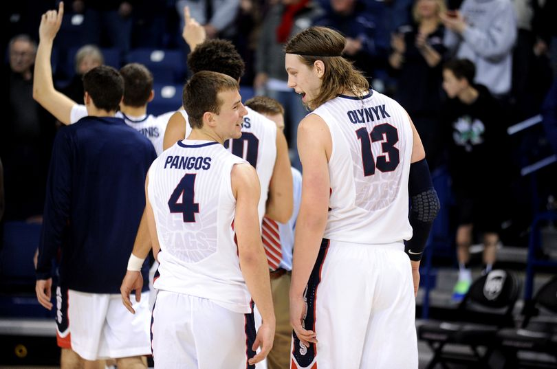 Gonzaga's Kevin Pangos and Kelly Olynyk are all smiles on the walk back to the locker room after beating Baylor. (Tyler Tjomsland)