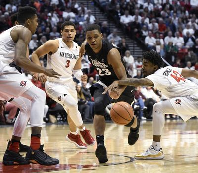 Gonzaga's Zach Norvell Jr. dribbles into traffic against a trio of San Diego State players. (Denis Poroy / Associated Press)
