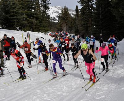 The Langlauf field is off and skiing for Sunday's 10-kilometer race, including overall winner Brett Ford (wearing yellow cap). (Rich Landers / The Spokesman-Review)