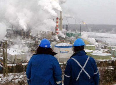 Workers overlook the processing plant at the Suncor tar sands project in Ft. McMurray, Alberta.   (Canadian Press / The Spokesman-Review)