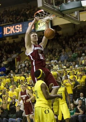 Cougars center Aron Baynes dunks over Oregon guard Tajuan Porter during the second half.  (Associated Press / The Spokesman-Review)