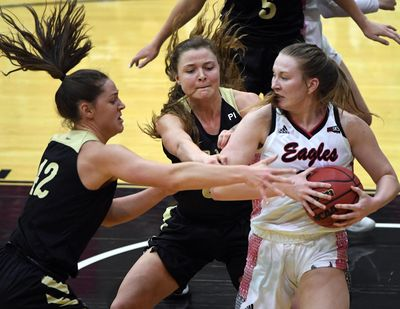Idaho's Natalie Klinker, left, and Lizzy Klinker, center, give Eastern Washington's Grace Kirscher a taste of defense honed in Montana. (Colin Mulvany / The Spokesman-Review)
