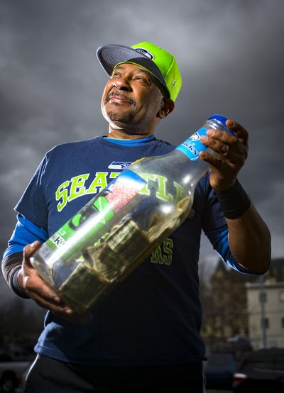 Gene Aikens found success quitting smoking by putting the money he would have bought cigarettes with into a bottle bank. Aikens is the newest face of the health district's Done My Way antismoking campaign. (Colin Mulvany / The Spokesman-Review)