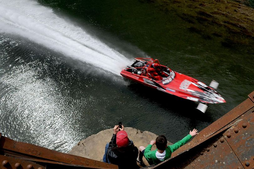 Paul Brebner, left, of St. Maries,  and Logan Dianda, 10 of Medical Lake, watch the 2012 World Jet Boat Races from a railroad bridge April 15, 2012, above the St. Joe River in St. Maries. (Kathy Plonka / The Spokesman-Review)
