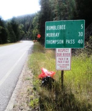 Who's to blame for all the litter along the North Fork? Shoshone County Sheriff Mitch Alexander is reluctant to point fingers. But evidence exists to show that Kootenai and Spokane county residents probably are. Here's a directional sign from the area. (Shoshone County SD courtesy photo)