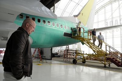 Bret Burnside, president of Cascade Aerospace USA, walks around a Boeing business jet being fitted with an executive interior at Cascade's facility at Spokane International Airport on Thursday. The company, which provides maintenance on commercial and private aircraft, held its official opening Thursday.  (Jesse Tinsley / The Spokesman-Review)