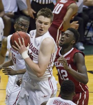 In this Dec. 22, 2015 file photo, Washington State forward Josh Hawkinson, front left, controls a rebound as Oklahoma forward Khadeem Lattin watches during the first half of the Diamond Head Classic. Hawkinson will play for the Pac-12 team this summer in Australia. (Eugene Tanner / Associated Press)