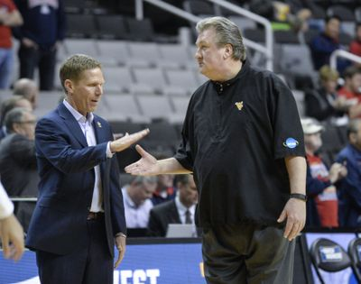 Gonzaga coach Mark Few greets West Virginia Bob Huggins before the first half of their NCAA Sweet Sixteen game, March 23, 2017, in San Jose. (DAN PELLE/The Spokesman-Review)