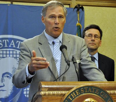 Gov. Jay Inslee discusses the change in federal policy toward marijuana enforcement while state Attorney General Bob Ferguson looks on. (Jim Camden)