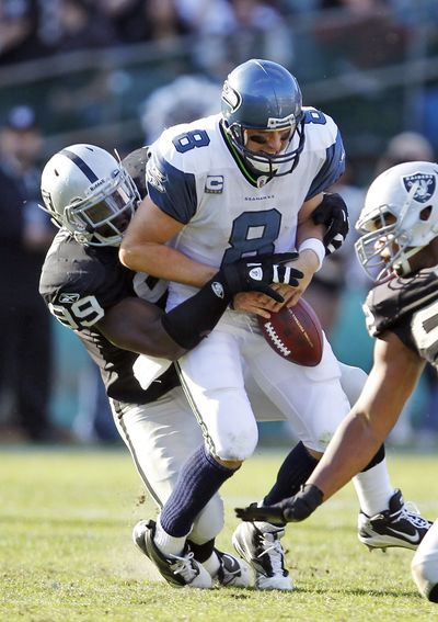 Quarterback Matt Hasselbeck and the Seahawks' offense have dropped the ball time and time again. (Associated Press)