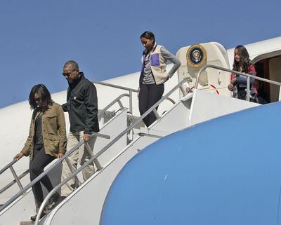 President Barack Obama and first lady Michelle Obama, followed by daughters Sasha and Malia, arrive Thursday on Air Force One at San Carlos de Bariloche in Bariloche, Argentina. (Pablo Martinez Monsivais / Associated Press)