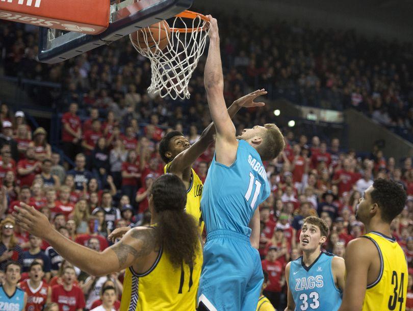 Gonzaga's Domantas Sabonis (11) dunks on Northern Arizona, Nov. 18, 2015, at the McCarthey Athletic Center. (Dan Pelle / The Spokesman-Review)