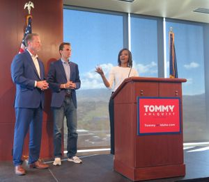 Conservative commentator Candace Owens, right, speaks at a press conference in Boise endorsing Tommy Ahlquist for governor of Idaho on Monday, April 30, 2018, along with Charlie Kirk, center, and Ahlquist, left. (The Spokesman-Review / Betsy Z. Russell)