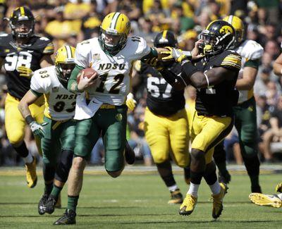 North Dakota State junior quarterback Easton Stick is known for his mobility. (Charlie Neibergall / Associated Press)