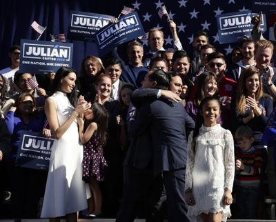 Former San Antonio Mayor and Housing and Urban Development Secretary Julian Castro, center right, is embraced by his twin brother U.S. Rep. Joaquin Castro (D-San Antonio), center left, during an event where Julian Castro announced his decision to seek the 2020 Democratic presidential nomination, Saturday, Jan. 12, 2019, in San Antonio. (Eric Gay / Associated Press)