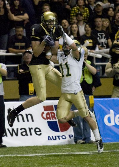 Idaho wide receiver Eric Greenwood, left, catches a first-half touchdown. University of Idaho (Bruce Mann University of Idaho / The Spokesman-Review)