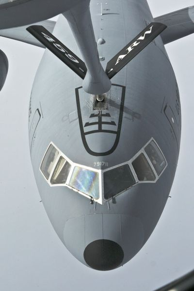 In this Feb. 10, 2009, file photo, a KC-10 plane takes part in a refueling exercise with an Air Force KC-135 plane over the Atlantic Ocean about 300 miles east of New York. After more than 50 years as the military's gas station in the sky – and a decade of attempts to replace it – the KC-135 is showing its age.  (Associated Press)