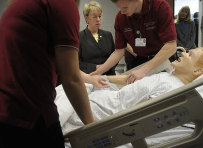 Sen. Patty Murray tours the new College of Nursing Building at the Riverpoint Campus on Wednesday. Nursing students Courtney Yant, left, and Viktor Rybachuk demonstrate a teaching mannequin connected to a computer that gives audio feedback during exams.  (CHRISTOPHER ANDERSON / The Spokesman-Review)
