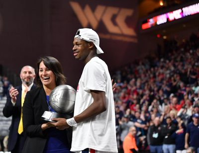 Gonzaga's Joel Ayayi receives the WCC Tournament MVP trophy from conference commissioner Gloria Nevarez following the Zags' win over Saint Mary's in the title game. (Tyler Tjomsland / The Spokesman-Review)