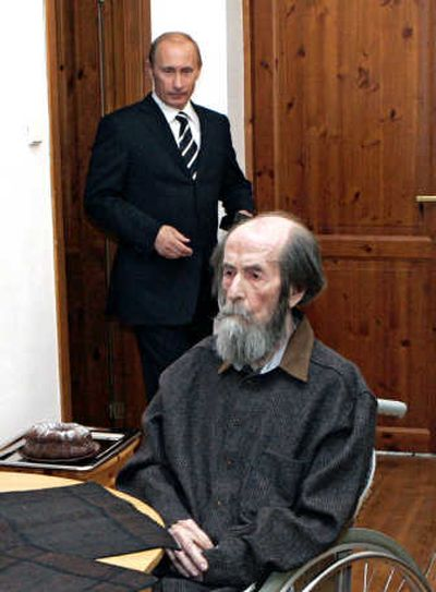 Russian President Vladimir Putin visits Alexander Solzhenitsyn, 88,  in  the outskirts of Moscow on Tuesday to give the formerly exiled Nobel laureate  an award for humanitarian achievement.   (Associated Press / The Spokesman-Review)