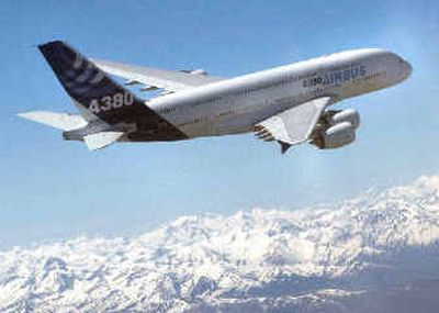 The Airbus A380 flies past the Pyrenees mountains during its maiden flight on Wednesday.   (Associated Press / The Spokesman-Review)