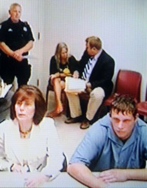 Robbie  Bishop ( front right ) appears via closed circuit video in the Superior Court of Judge Sam Cozza Monday August 24, 2009. CHRISTOPHER ANDERSON chrisa@spokesman.com (Christopher Anderson / The Spokesman-Review)