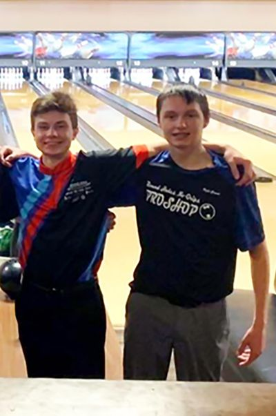 Alex Holodnick, left, won the recent Junior Bowlers Tour stop at Players & Spectators, while Kyle Groves, right, bowled a 300 game. (Cindi Snyder / Courtesy)