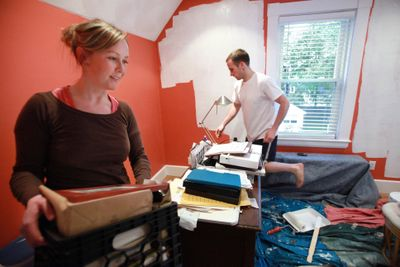 Kurt Spring and his girlfriend, Holly Dewar, both of Melrose, Mass., paint a room in their  home. They are restoring the house after purchasing the 19th-century structure for $340,000 in January. The house was vacant for two years before the couple bought it.  (Associated Press / The Spokesman-Review)