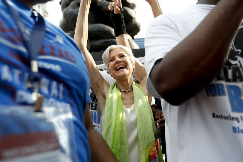Dr. Jill Stein, presumptive Green Party presidential nominee, waves at a rally in Philadelphia, Wednesday, July 27, 2016, during the third day of the Democratic National Convention. (AP Photo/Alex Brandon)