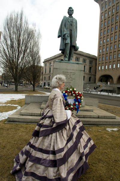 Annie Pierce of the Daughters of the American Revolution in Spokane spent two weeks sewing a period dress to celebrate the 200th anniversary on Thursday of President Abraham Lincoln's birth on Feb. 12, 1809. She was part of a wreath-laying ceremony at the city's Lincoln Statue at Main and Monroe downtown.   (Colin Mulvany / The Spokesman-Review)
