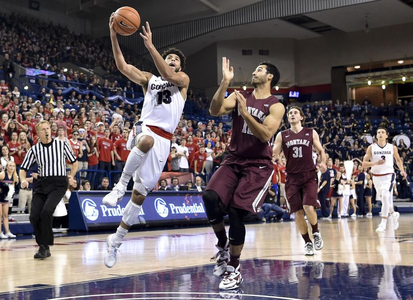 Gonzaga guard Josh Perkins (13) drives to the hoop against Montana during the first half of a college basketball game on Tuesday, Dec 8, 2015, at McCarthey Athletic Center in Spokane, Wash. (Tyler Tjomsland / The Spokesman-Review)
