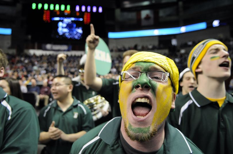 Anthony DeRusso, a trombone player with the Siena band, shouts