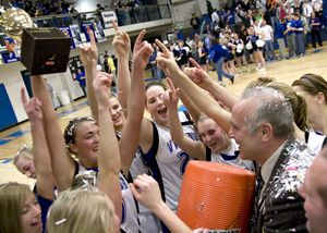 Coach Dale Poffenroth and his Coeur d'Alene team celebrate beating Post Falls.Special to  (Bruce Twitchell Special to / The Spokesman-Review)