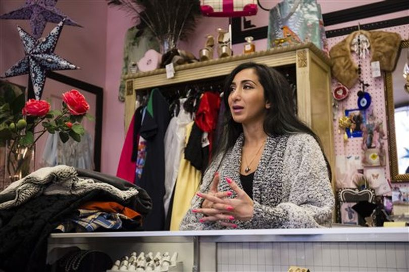 Liyah Babayan talks to a reporter in her boutique in Twin Falls, Idaho. The former refugee from Azerbaijan, now a U.S. citizen, said the recent arguments against accepting refugees are just a mask for a minority group to peddle racism and fear. (AP / Otto Kitsinger)