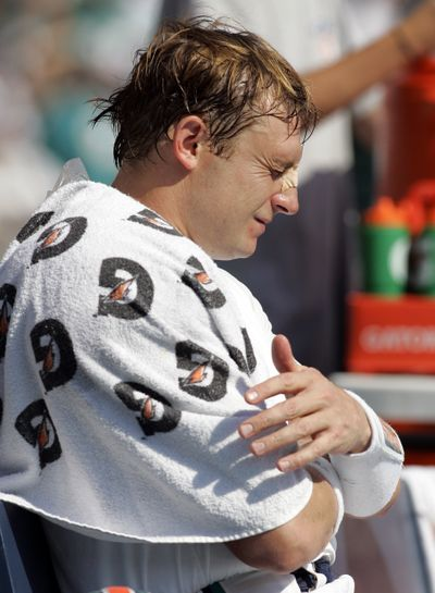 Shoulder injury likely to sideline Dolphins' QB Chad Pennington. (Associated Press / The Spokesman-Review)
