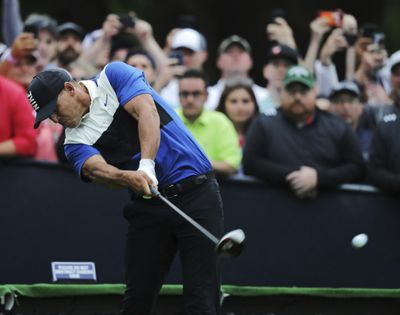 Brooks Koepka hits off the 16th tee during the final round of the PGA Championship, Sunday, May 19, 2019, at Bethpage Black in Farmingdale, N.Y. (Charles Krupa / AP)
