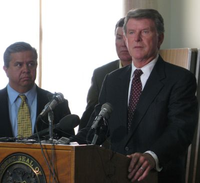 Idaho Gov. Butch Otter announces budget cuts Friday, as  Superintendent of Schools Tom Luna, left, and House Assistant Majority Leader Scott Bedke, R-Oakley, look on. (Betsy Russell / The Spokesman-Review)