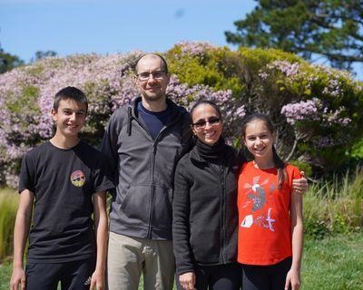 Sava Iliev, 15, Rado Iliev, 42, Ellie Pojarska, 44, and Raya Iliev, 11, stand at the end of their street where they start all their walks as a family in Belmont, California.  (Assad Rajani)