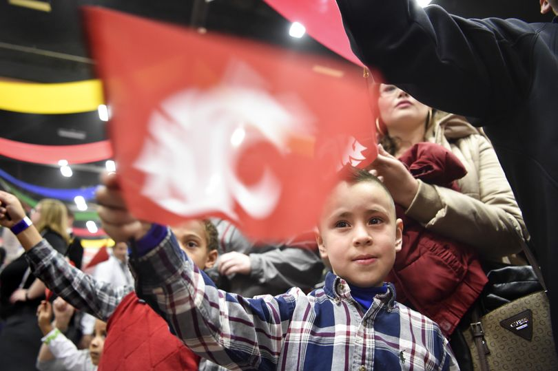 Diego Favela, 5, cheers with his sister Angela, standing behind him, during the 19th annual Hyundai Sun Bowl Fan Fiesta on Friday  at Judson F. Williams Convention Center in El Paso, Texas. (Tyler Tjomsland / The Spokesman-Review)