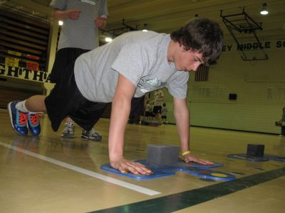 Cheney Middle School student Micah Weller does push-ups during his fitness assessment.  (Lisa Leinberger / The Spokesman-Review)