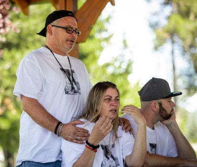 Parents Frank Stabile and Jennifer Stabile with son Charlie Drapeau grieve during a gathering Monday in Coeur d'Alene to remember Michael Stabile, who died after an overdose.  (Libby Kamrowski/The Spokesman-Review)