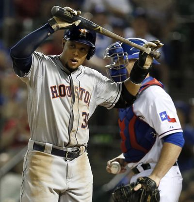 Chris Gimenez, right, predicts the Rangers will keep rolling after sweeping the Astros. (Associated Press)