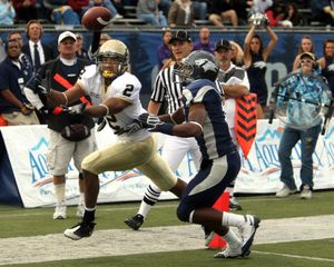ORG XMIT: NVCA102 Idaho's Maurice Shaw tries to come up with a pass against Nevada defender Doyle Miller, right, in the third quarter of an NCAA college football game, Saturday Oct. 24, 2009, in Reno, Nev. Nevada won 70-45.  (AP Photo/Cathleen Allison) (Cathleen Allison / The Spokesman-Review)