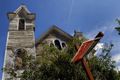 The former St. Joseph Catholic Church in Spirit Lake, built in 1908, is barely more than a shell. It is being sold for $145,000.   (Kathy Plonka / The Spokesman-Review)
