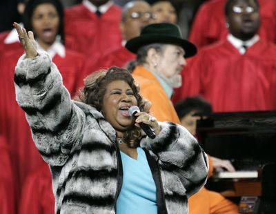 Aretha Franklin and Dr. John, background on piano, perform the national anthem before the Super Bowl XL on Feb. 5, 2006, in Detroit. Franklin died Thursday, Aug. 16, 2018 at her home in Detroit. She was 76. (Gene J. Puskar / Associated Press)