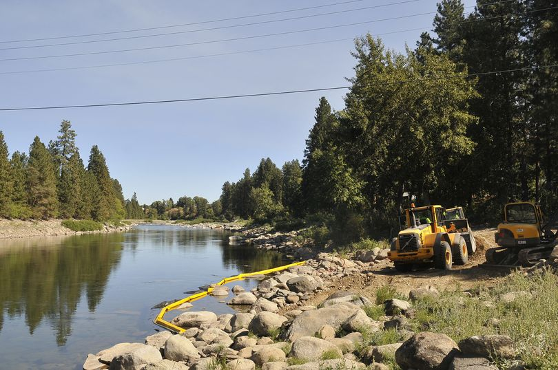 Machines operated by Piersol Construction scrape dirt from the Flora Road landing along the Spokane River on Thursday. (Jesse Tinsley)