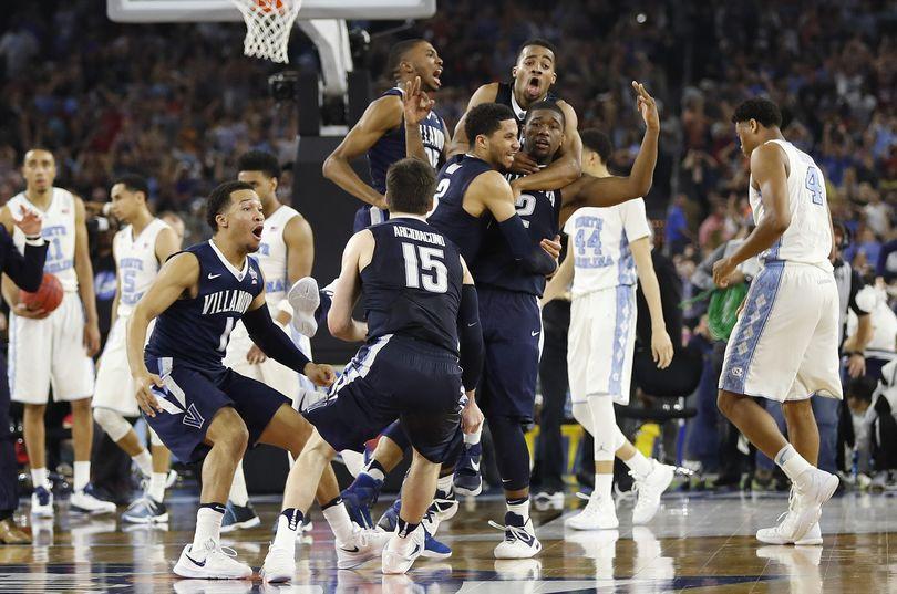 Villanova players celebrate their national championship after defeating North Carolina 77-74. (David J. Phillip / Associated Press)