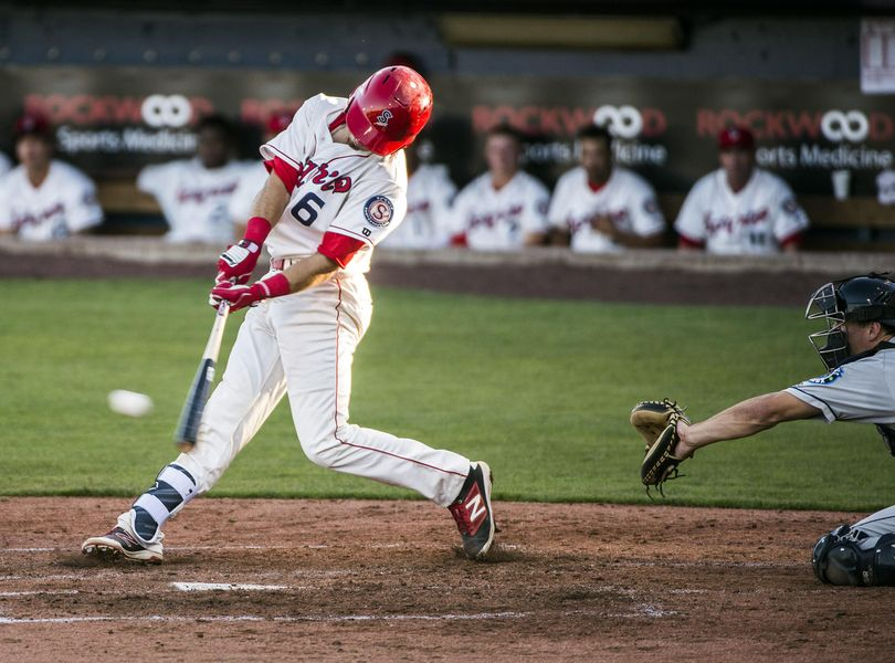 Spokane's Seth Spivey rips a double in the fourth inning of a 9-3 victory over the Everett AquaSox at Avista Stadium on Wednesday. (Dan Pelle / The Spokesman-Review)